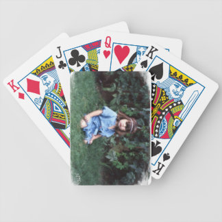 Mylune sitting in the grass bicycle playing cards