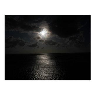 Mysterious white sun in black sky postcard