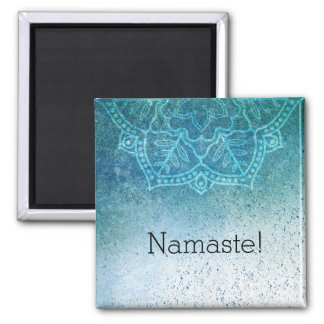 Namaste fridge magnet with lotus design.