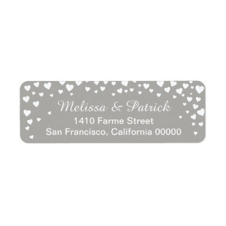 names with love hearts confetti on gray wedding