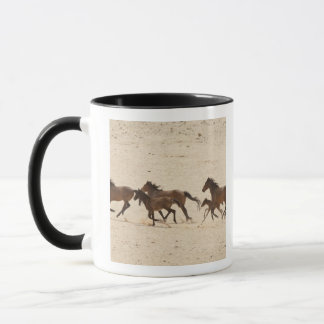 Namibia, Aus. Group of running wild horses on Mug
