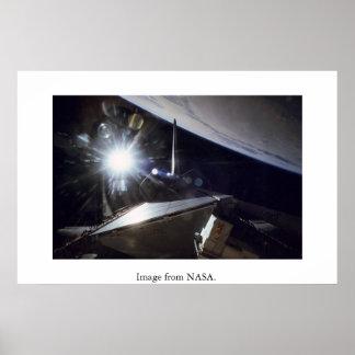 NASA: Shuttle Endeavor sunburst over Earth. Poster