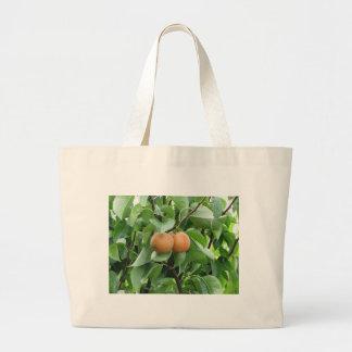 Nashi pears hanging on tree large tote bag