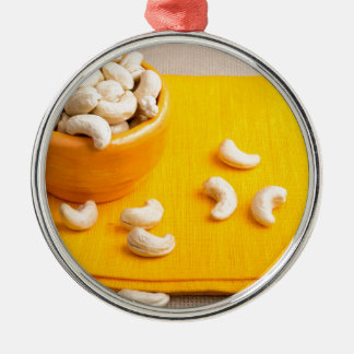 Natural and healthy cashew nuts for raw foodists Silver-Colored round ornament