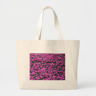 Natural background of purple carnation flowers large tote bag