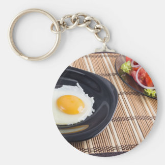 Natural homemade breakfast of fried egg and salad basic round button keychain