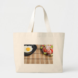 Natural homemade breakfast of fried egg and salad large tote bag