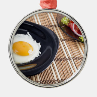 Natural homemade breakfast of fried egg and salad Silver-Colored round ornament