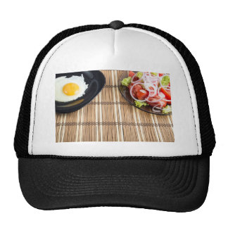 Natural homemade breakfast of fried egg and salad trucker hat