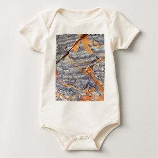 Natural layers of agate in a sandstone baby bodysuit