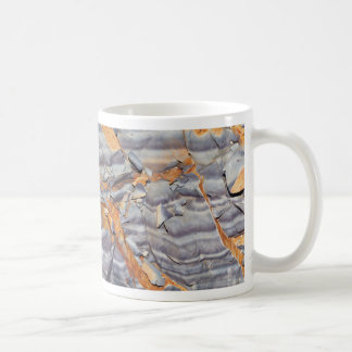 Natural layers of agate in a sandstone coffee mug