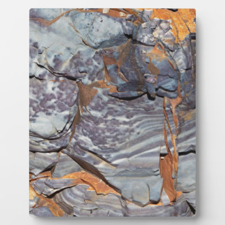Natural layers of agate in a sandstone plaque