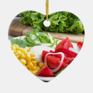 Natural salad of tomatoes, mozarella cheese ceramic heart ornament