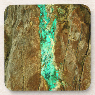 Natural turquoise vein in rough brown stone coaster