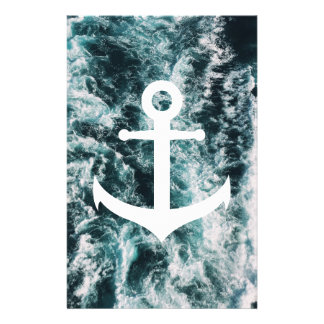 Nautical anchor on ocean photo background stationery