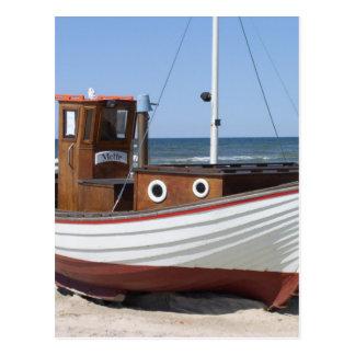 Nautical Fishing Boat sitting on Sandy Ocean Beach Postcard
