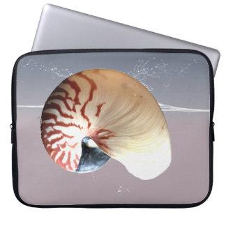 Nautilus shell on splash of ocean laptop sleeve
