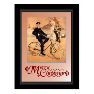 Naval man on a bicycle postcard