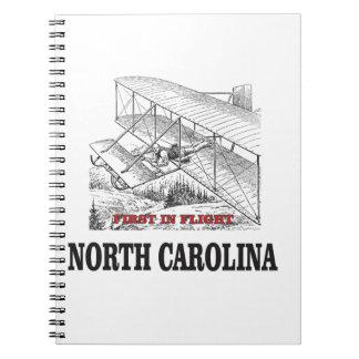 NC first in flight Spiral Notebook