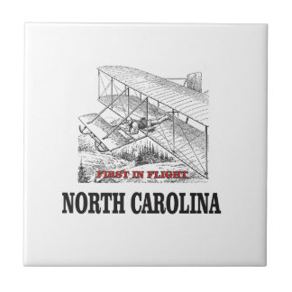 NC first in flight Tile