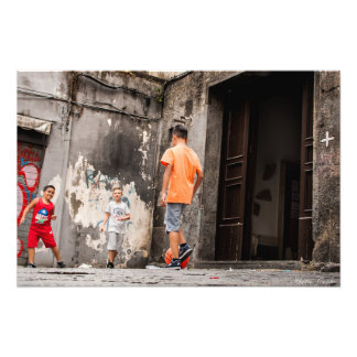 Neapolitan kids play football in an alley photo