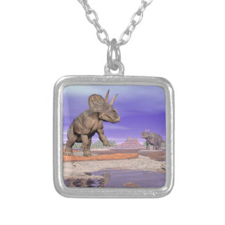 Nedoceratops/diceratops dinosaurs in nature silver plated necklace