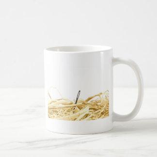 needle in a haystack coffee mug