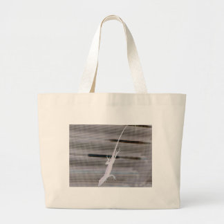 Negative image of a lizard on a window screen large tote bag
