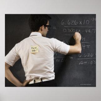 Nerdy man writing on blackboard poster