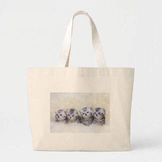 Nest with four young tabby cats in a row large tote bag