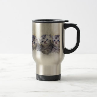 Nest with four young tabby cats in a row travel mug