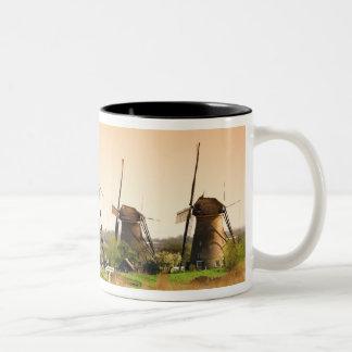Netherlands, Kinderdijk. Windmills next to Two-Tone Coffee Mug
