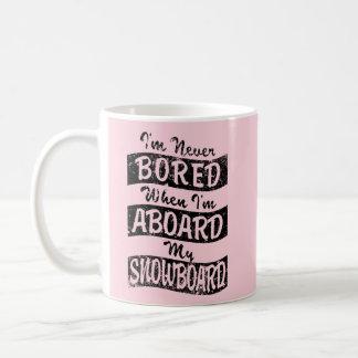 Never Bored ABOARD my SNOWBOARD (Blk) Coffee Mug