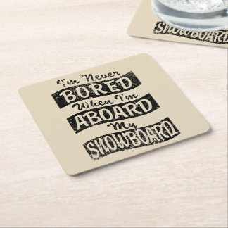 Never Bored ABOARD my SNOWBOARD (Blk) Square Paper Coaster