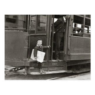 Newsboy Riding Trolley, 1910 Postcard