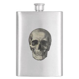 Newspaper skull flasks