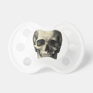 Newspaper skull pacifier