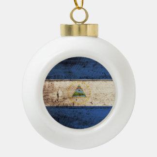 Nicaragua Flag on Old Wood Grain Ceramic Ball Christmas Ornament