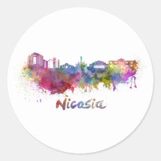 Nicosia skyline in watercolor classic round sticker