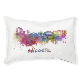 Nicosia skyline in watercolor pet bed