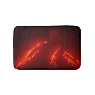 Night eruption volcano: glowing lava flow bathroom mat