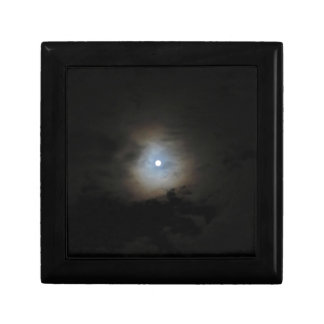 Nighttime sky with brightly lit full moon gift box