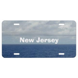 NJ Blue Sea Fluffy Clouds Decorative License Plate