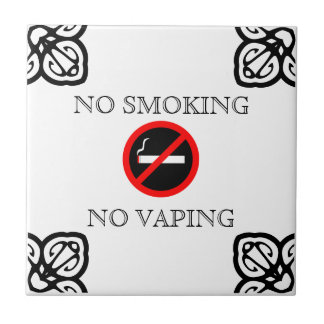 NO SMOKING SIGN ON SPANISH TILE