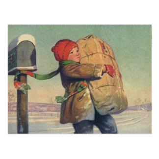 Noël vintage, enfant avec le paquet carte postale