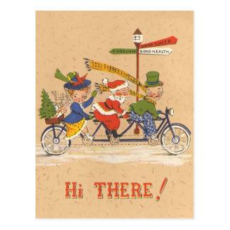 Noël vintage, le père noël montant un vélo carte postale