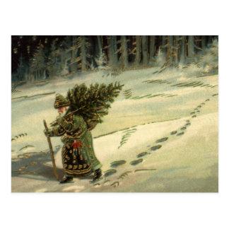 Noël vintage, le père noël portant un arbre carte postale