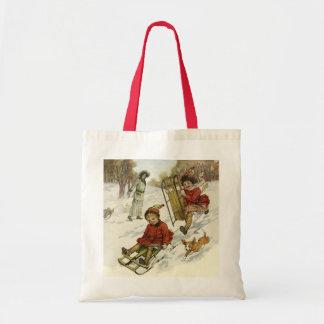 Noël vintage, traîneau victorien d'enfants dans la sac en toile budget