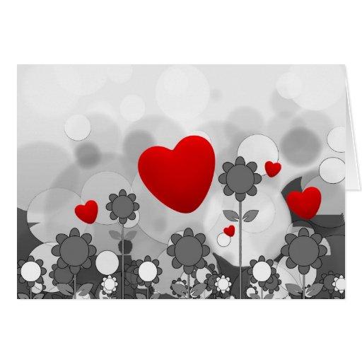 Noir/blanc mignon/gris fleurit le coeur de rouge d carte de vœux