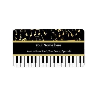 Noir et or de notes musicales et de clés de piano étiquette d'adresse